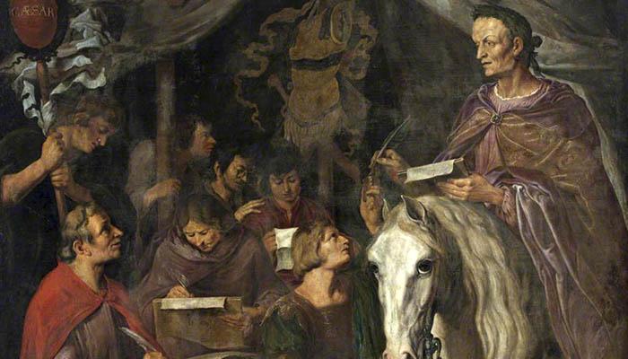 Julio César a caballo, escribiendo y dictando simultáneamente a sus escribas